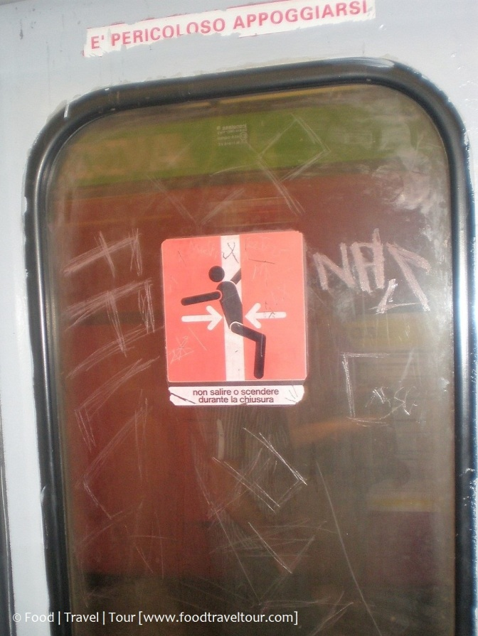 Milan train sign